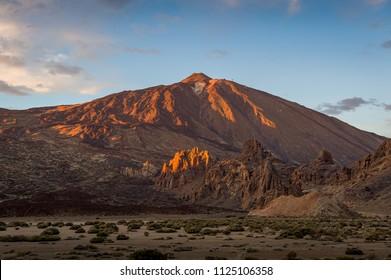 El Teide volcano at sunset light. Beautiful evening landscape at Tenerife highland desert. Canarias, Spain.