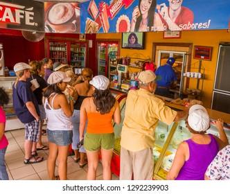EL VALLE de ANTON, PANAMA - AUGUST 16, 2009: People at Quesos Cela roadside restaurant, serving famous empanadas.