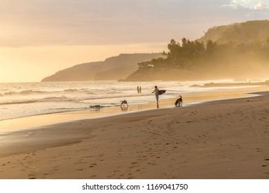 El Zonte, El Salvador. February 2018. A view of a surfer on the beach in El Zonte in El Salvador.