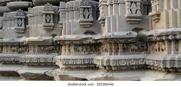 Elaborate carvings and sculpture at the base of the  Duladeo Shiva Temple Khajuraho,  India