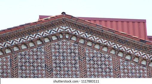 Elaborate colorful brick design on commercial building gable