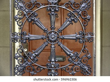 Elaborate ornamental ironwork with radial symmetry near front door of house in historic district of Savannah, Georgia, USA