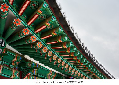The elaborate traditional Korean roof decoration, called dancheong, is shown under the roof of a traditional architecture in Changdeokgung Palace in Seoul, Korea.