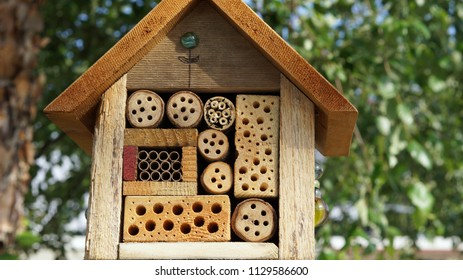 Elaborately carved wooden birdhouse