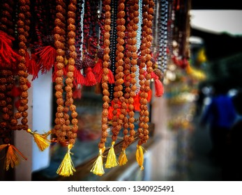Elaeocarpus ganitrus pearl's garlands in India used for the prayers for Shiva, that is know as Rudraksha. Rudraksha Garlands are hanging on the street of Varanasi.