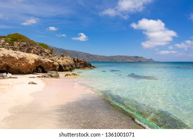 Elafonisi beach with pink sand, warm and crystal clear water. Crete Island, Greece