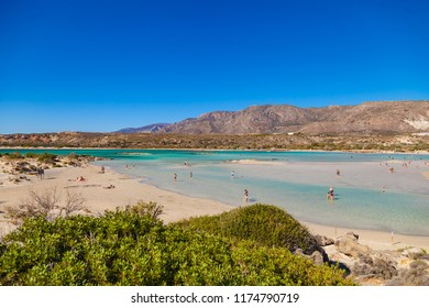 ELAFONISI, CRETE,  GREECE - AUGUST 14, 2018: People swimming and rest at Elafonisi beach. The heavenly wild beach with turquoise water.