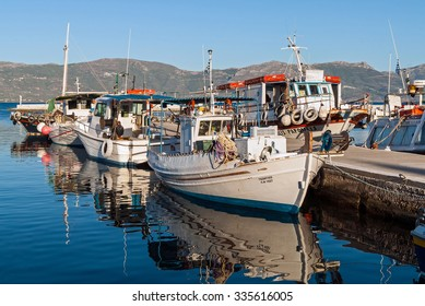 ELAFONISOS ISLAND OF PELOPONNESE, GREECE - OCTOBER 12, 2013: Traditional wooden fishing boats in the harbor. Fishing in wooden traditional boats remains an important part of the local economy.