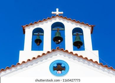 ELAFONISOS, LAKONIA - JULY 2018: Aghios Spyridon little white church architectural details on the small island of Elafonosos, Lakonia, Greece