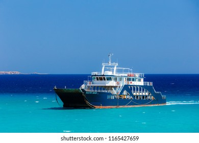 ELAFONISOS, LAKONIA - JULY 2018: Ferry boat crossing the strait between Elafonisos and Pounda with the beautiful sea waters