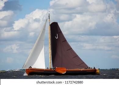 Elahuizen, Friesland, The Netherlands - August 10, 2018; Skŭtsjesilen is a Frisian regatta with skŭtsjes at the Frisian Lakes, Friesland, The Netherlands