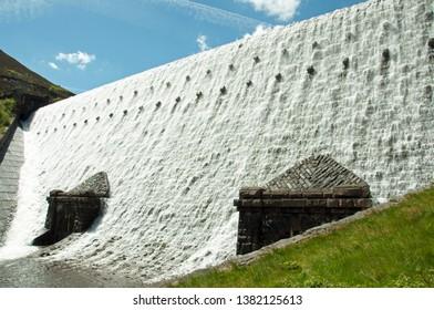 Elan valley dams of Wales in full flow in the summertime.
