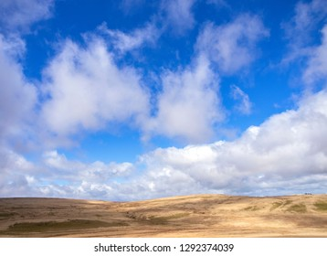 The Elan Valley in Wales under a blue sky with white, wispy clouds