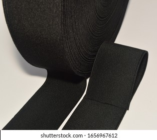 Elastic band isolated. Black elastic spool, the elastic band is made of polyester fibre.