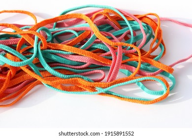 Elastic band for sewing clothes of different colors, on a white background.Household sewing concept. Selective focus.
