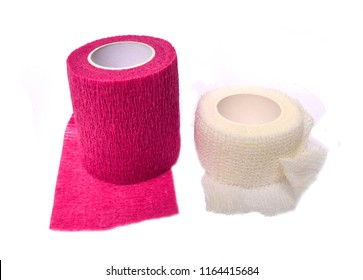 elastic cohesive bandage rolled up isolated on white background.