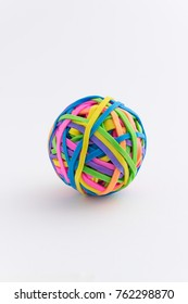 Elastic rubberband ball over white background