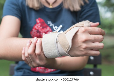 Elastic wrist support brace band wrap on hand to relieve pain, selective focus