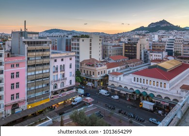 Elavated view of Central Market towards Lykavittos Hill at dawn, Monastiraki District, Athens, Greece, Europe 10 October 2017