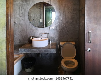 Elavation of loft bathroom or Vintage bathroom,architecture and design of public loft restroom sink and bathroom decoration idea.Interior of the bathroom decorated with loft style.