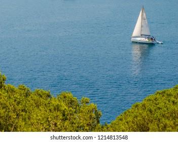 ELBA, ITALY - AUGUST 2, 2018: Sailing boat on Porto Azzurro on the Elba Island.