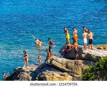 ELBA, ITALY - JULY 31, 2018: People on the cliff of the Cavoli Beach on the Elba Island.