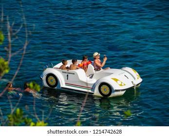 ELBA, ITALY - JULY 31, 2018: Family in holiday on the Cavoli Beach on the Elba Island.