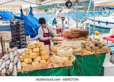 Elba, Italy - May, 2015: Cheese trade tent on the market at Elba Island