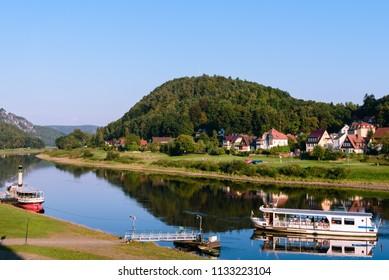 Elbe. Ferry boat on river Elbe in Stadt Wehlen. Saxon Switzerland National Park, Germany.