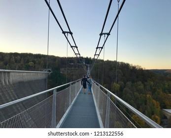 Elbingerode, Germany - 13. Oktober 2018. Titan RT Bridge, one if the longest Suspension Bridges in the world in the Harz, Germany. Panorama of the Titan RT Bridge in the autumn time.