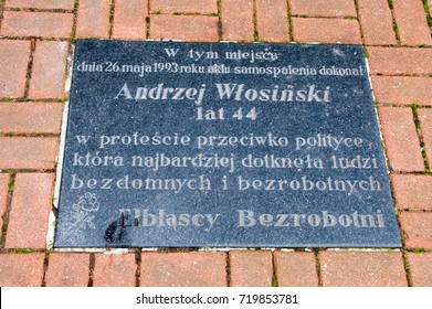 Elblag, Poland - September 9, 2017: Board for commemorate a self-immolation by Andrzej Wlosinski in May 26, 1993.