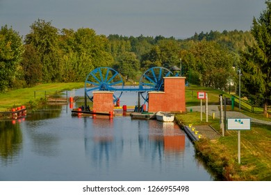 The Elblaski Canal, Poland - a waterway in the Warmian-Masurian Voivodeship. A chrysanthemum that is sloping alongside small passenger ships. Recognized as one of the seven Polish wonders