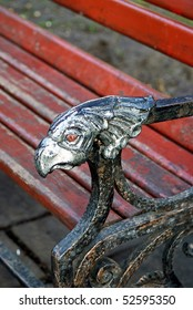 elbow of bench as head of griffin