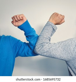 Elbow bump - a new and safe way of greeting to avoid the spread of coronavirus (COVID-19), an alternative to handshake and hugging