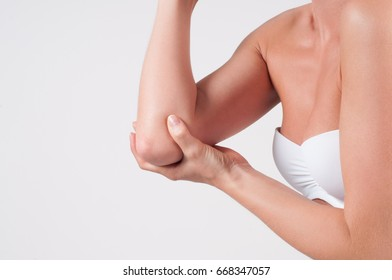 Elbow pain. Woman has elbow pain. Pain in the joints of the hands, health care concept.