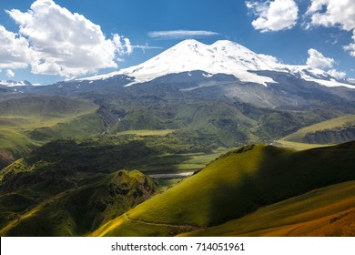 Elbrus And Green Hills At Sunny Summer Day. Elbrus Region, North Caucasus, Russia