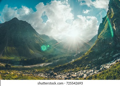 Elbrus, the Irik river valley, the sunset in the mountains, the sun illuminates a mountain valley with rivers, a summer mountain landscape.