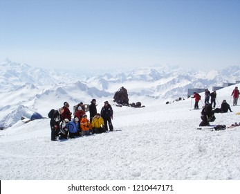 ELBRUS REGION, RUSSIA - MARCH 18, 2007: Skiers and snowboarders take groupe photo on Elbrus mountain ski resort at winter day.