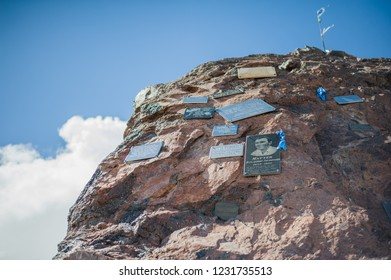 ELBRUS, RUSSIA - July 05: Stone with memorial signs on the slope of Mount Elbrus in July 05, 2015 in Elbrus, Russia