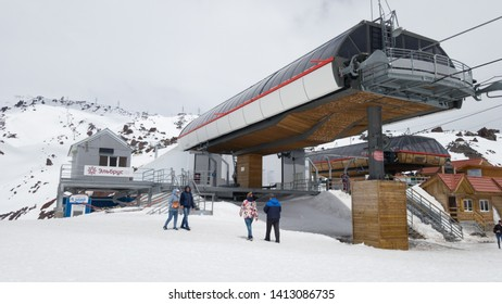Elbrus, Russia - May 12, 2019: Mir station on mount Elbrus. Visible cable car station and tourists visiting Elbrus on a spring day