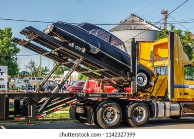 """ELBURN, IL/USA - JULY 25, 2018: A classic black Buick is ready for delivery in this small town, a location for scenes of """"Lovecraft Country,"""" a dramatic TV series set in the 1950s to be aired on HBO."""
