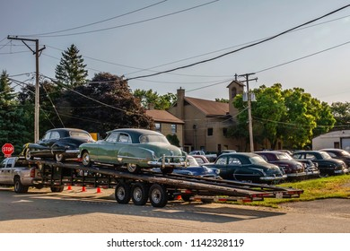 """ELBURN, IL/USA - JULY 25, 2018: Classic cars brought to this small town will add atmosphere to scenes about to be filmed for """"Lovecraft Country,"""" a TV series set in the 1950s to be aired on HBO."""