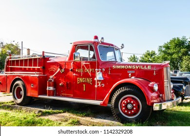 "ELBURN, IL/USA - JULY 25, 2018: A vintage fire engine in the fictional town of Simmonsville, a smalltown stopover in ""Lovecraft Country,"" a dramatic TV series set in the 1950s to be aired on HBO."