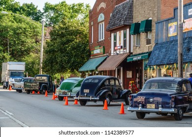 "ELBURN, IL/USA - JULY 25, 2018: Classic cars on Main Street in this small town add atmosphere for scenes about to be filmed for ""Lovecraft Country,"" a TV series set in the 1950s to be aired on HBO."