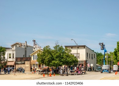 """ELBURN, IL/USA - JULY 25, 2018: A camera operator on an aerial work platform (right) stands ready for the first take of the day for """"Lovecraft Country,"""" a dramatic pilot for HBO set in the 1950s."""