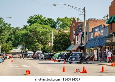 """ELBURN, IL/USA - JULY 25, 2018: Morning preparations near a final stage along Main Street before local filming of """"Lovecraft Country,"""" a TV series set in the 1950s to be aired on HBO."""