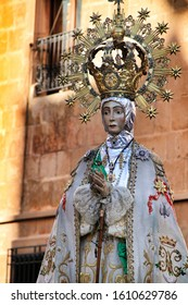 Elche, Alicante, Spain- December 29, 2019: Virgin of the Assumption accompanied by parishioners in procession for the streets of Elche for its festivity