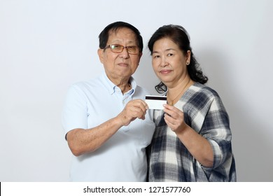 The elder Asian couple on the white background.