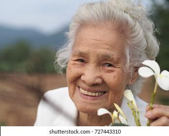 Elder Asian woman enjoying her day