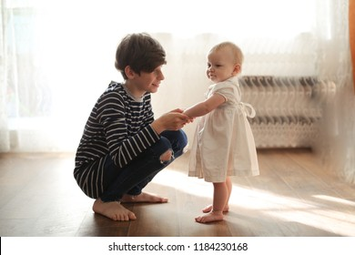 The elder brother cares with the little sister Toddler, real interior and sincere emotions, concept relations of siblings